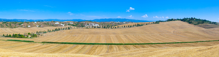 Wide panoramic landscape of Tuscan countryside during summertime. Stock Photo
