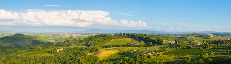 Wide panoramic landscape of surroundings of the medieval city of San Giminiano, Tuscany, Italy.