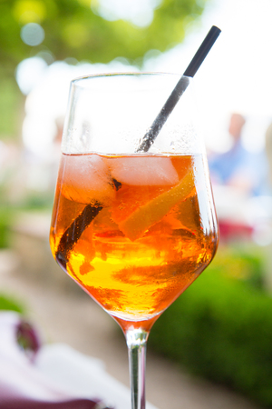 bitter orange: Close up of a glass of spritz cocktail, made of sparkling wine, bitter orange Italian aperitif, ice and orange slices.