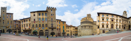Arezzo, Italy - August 1, 2016: The Piazza Grande square, located in the old town of Arezzo, Tuscany, Italy.