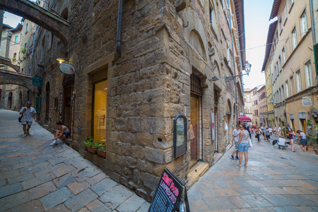 Volterra, Italy - August 3, 2016: Wide angle view of the streets of the medieval city of Volterra, Tuscany, Italy.