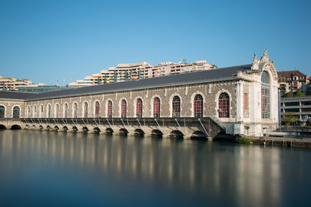 Long exposure view of the Batiment des Forces Motrices on the Rhone river, Geneva - Switzerland. Stock Photo