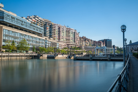 Long exposure view of the dam on the Rhone river, in Geneva city center. Stock Photo