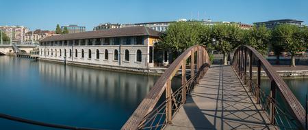 Panoramic, long exposure view of Geneva city center at morning time.