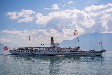 Vevey, Switzerland - September 25, 2016: The La Suisse passenger steamboat leaving the city of Vevey, Switzerland.