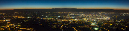 Wide aerial panoramic view of the canton of Geneva at night.