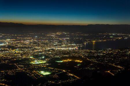 Aerial view of the city of Geneva at night, Switzerland. Stock Photo