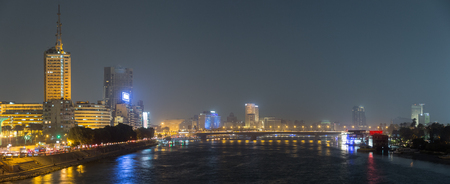 Panoramic night view of Cairo center, the Nile river and the island of Zamalek, in the distance the 6th October bridge and the city skyscrapers.