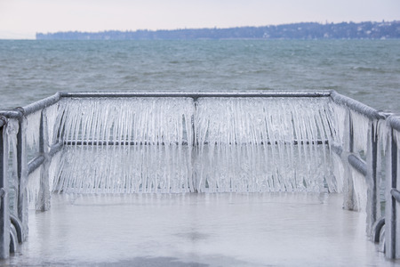 Fence covered with icicles after a winter storm on Lake Geneva.
