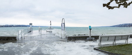 Panoramic view of Geneva lakeside promenade covered with ice further to a winter storm.