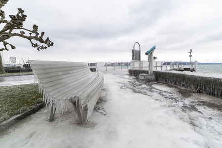 Lakeside promenade covered with ice after a winter storm on Lake Geneva. Stock Photo