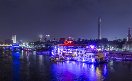 Cairo, Egypt - March 9, 2017: The Island of Zamalek in central Cairo at night, with its famous boat restaurants on the Nile river.