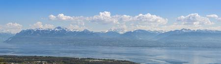 Panoramic view Lake Geneva and surrounding mountains during springtime.