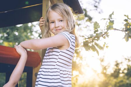 Blond girl at a playground. Stock Photo