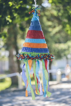 colorful cone shaped pinata Stock Photo - 80900472