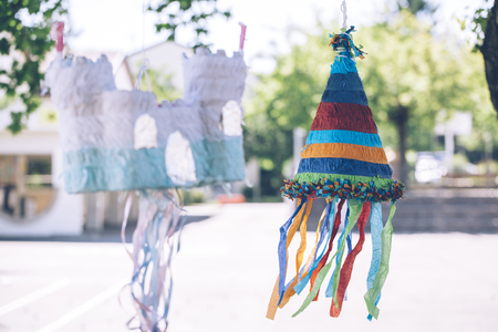 colorful castle and cone shaped pinatas