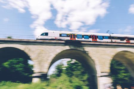 Geneva, Switzerland - June 25, 2017: Swiss regional train passing over a bridge in the Geneva Canton region, with motion blur. Editorial