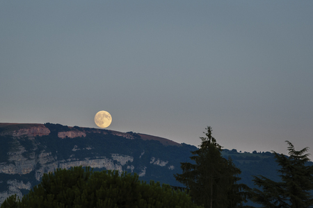 Full moon rising over the french alps.