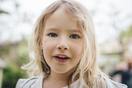 Portrait of a blond little girl Stock Photo - 84647059