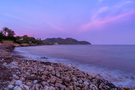 The mediterranean sea on the Spanish island of Mallorca at dusk. Stock Photo - 85255947