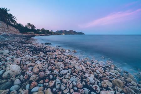 The mediterranean sea on the Spanish island of Mallorca at dusk. Stock Photo