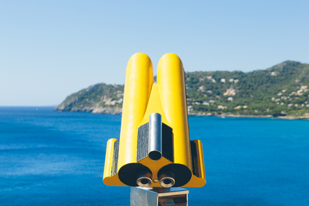 Coin operated binoculars overlooking the mediterranean sea on the island of Mallorca, spain.