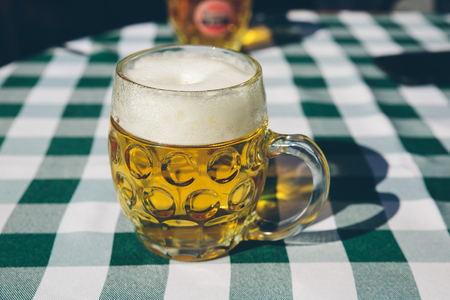 Mug of beer on a table Stock Photo
