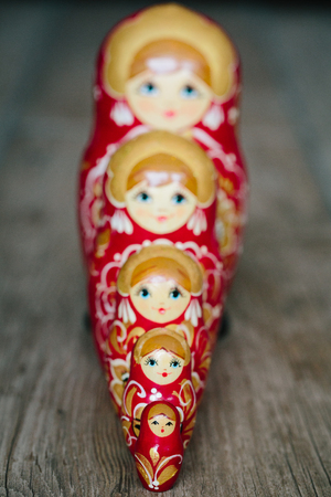 Matryoshka, or russian dolls aligned with focus on foreground.