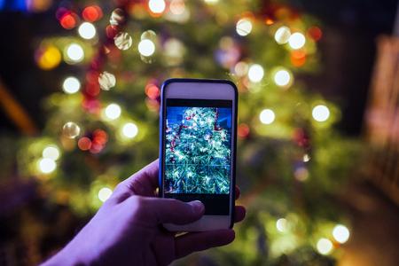 Christmas tree smartphone photo Stock Photo