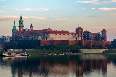 The Wawel castle at dusk in the old town of Krakow. Stock Photo