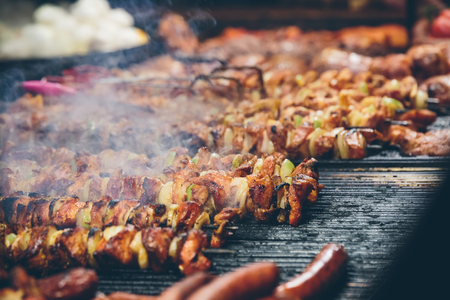 Meat skewers barbecued on a grill at  Krakows Christmas market. Stock Photo