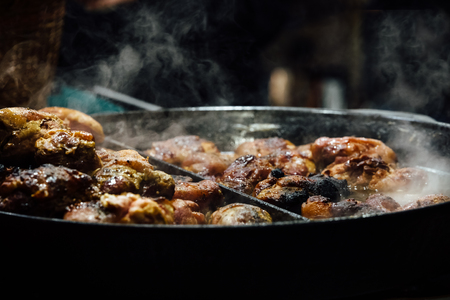 Pan fried beef cuts at  Krakows Christmas market on Rynek Glowny. Stock Photo