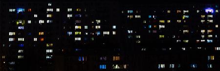 Suburban apartment buildings multi colored lights.