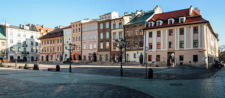 Wide angle view of the little market square, Maly Rynek, in the old town of Krakow, Poland.