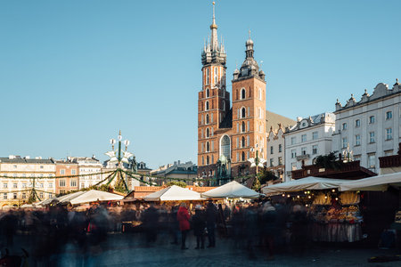 Krakow, Poland - December 30, 2017: Long exposure view of the Christmas market on Rynek Glowny, the main market square in the old town of Krakow, in the background the St Marys basilica. Editorial