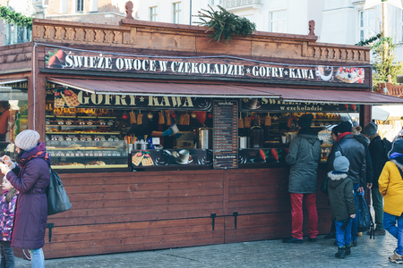 Krakow, Poland - December 30, 2017: Food kiosk at the Christmas market on Rynek Glowny, the main market square in the old town of Krakow.
