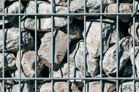 Welded mesh gabion willed with gabion stones. Stock Photo