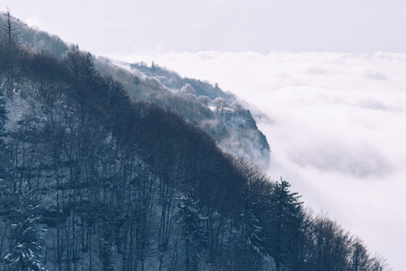 Mountain emerging from the winter fog.