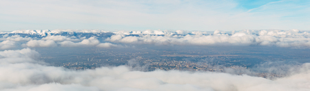 Wide angle aeria view of the canton of Geneva on a foggy winter day.