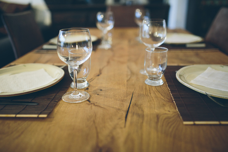 Wooden table with dining set. Stock Photo