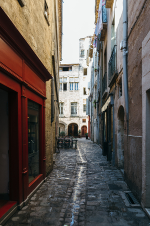 Narrow streets of the ancient city of Pezenas, France.