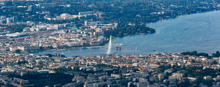 Aerial panoramic view of Geneva city center, water fountain and lake.