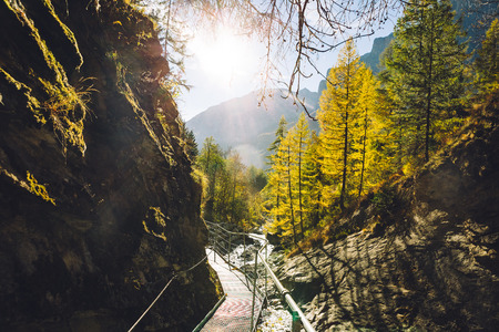 The footbridge of the Leukerbad themal springs (Dala gorge) during fall.