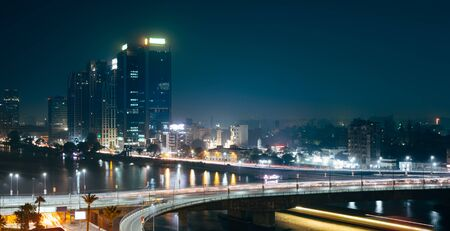 Traffic light trails in Cairo at night, the 15th May bridge, the Nile river and the Corniche Street Stock Photo