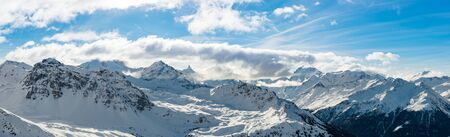 wide angle panoramic view of swiss alps during winter time.