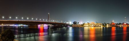 Panoramic of Cairo city center at night, long exposure with smoothed out water.