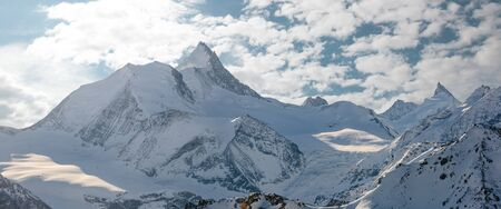 The Weisshorn and surrounding mountains in the swiss alps. Stock Photo