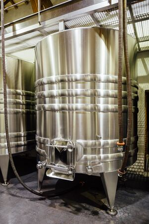 Stainless steel wine tank in a winery. Stock Photo