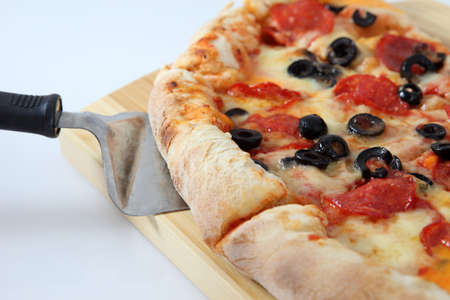 piece of pizza with yellow chease and black olive
