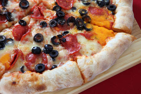 pizza with yellow chease and black olive